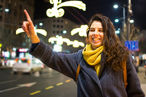An image of a woman hailing a cab