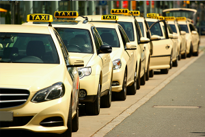 An image of a line of new taxis